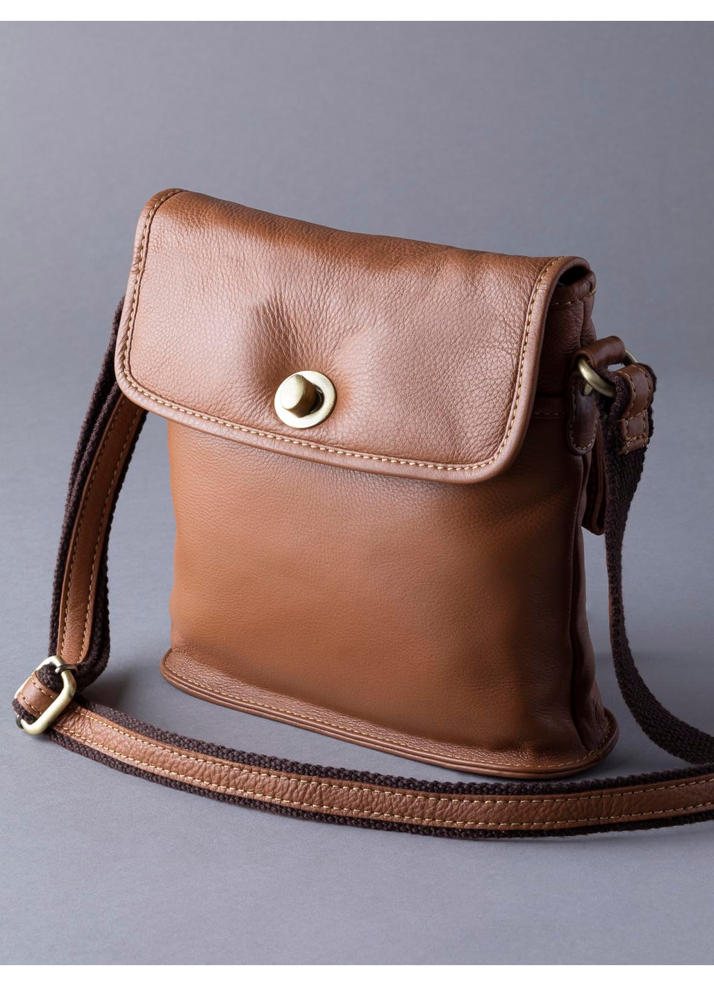 Rickerby Leather Turn Lock Cross Body Bag in Cognac